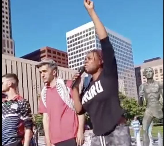 Members of the Black is Back Coalition speak in solidarity with the people of Palestine in St. Louis, MO.